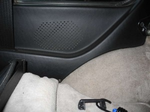 seat to the left; side window just above the speaker